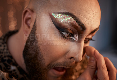Buy stock photo Cropped shot of a young man applying theatrical makeup to his face in a studio
