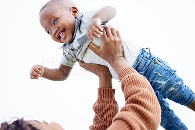Buy stock photo Shot of a mother playing with her son outside