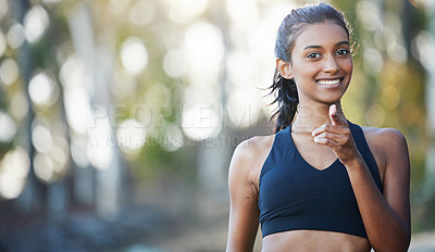 Buy stock photo Portrait of a sporty young woman exercising outdoors