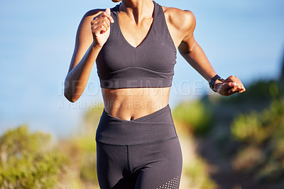 Buy stock photo Closeup shot of a sporty young woman running outdoors