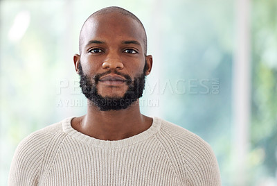Buy stock photo Shot of a young man standing at home