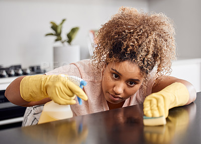 Buy stock photo Shot of a young woman cleaning a countertop at home