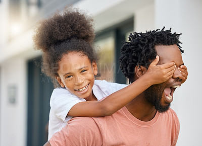 Buy stock photo Shot of a father carrying his daughter outside