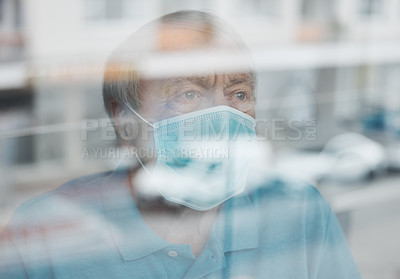 Buy stock photo Shot of a mature man looking out a window in a hospital