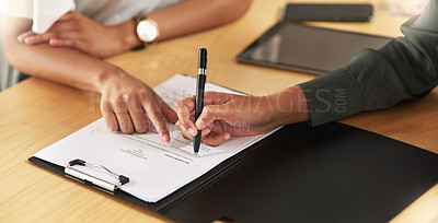 Buy stock photo Shot of a businesswoman signing a contract at work
