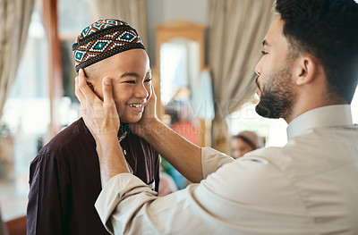 Buy stock photo Shot of a muslim father gazing affectionately at his son