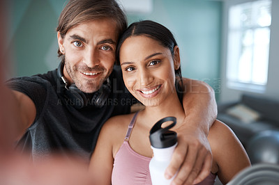 Buy stock photo Cropped portrait of an athletic young couple taking selfies before starting their workout at home