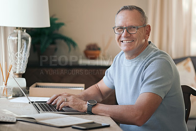Buy stock photo Shot of a mature man typing on his laptop