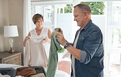 Buy stock photo Shot of a mature couple folding laundry together