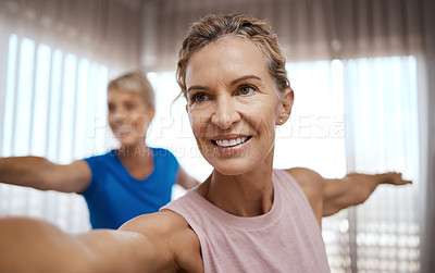 Buy stock photo Shot of two mature women exercising together at home