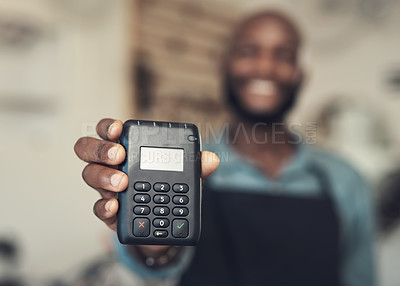 Buy stock photo Shot of an unrecognizable man standing in his bicycle shop and holding a card machine