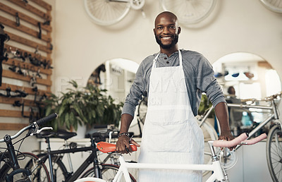 Buy stock photo Portrait of a proud business owner standing in his bicycle repair shop