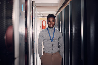 Buy stock photo Portrait of an attractive young man at work in a server room