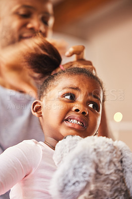 Buy stock photo Shot of a young father doing his daughter's hair at home