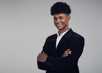 Buy stock photo Studio portrait of a confident young businessman posing against a grey background