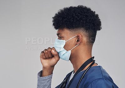 Buy stock photo Shot of a male nurse coughing while wearing a face mask