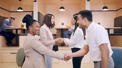 Buy stock photo Shot of a diverse group of businesspeople standing in the office together and shaking hands during a discussion