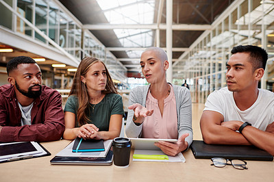 Buy stock photo Cropped shot of a group of young businesspeople having a meeting in their office boardroom