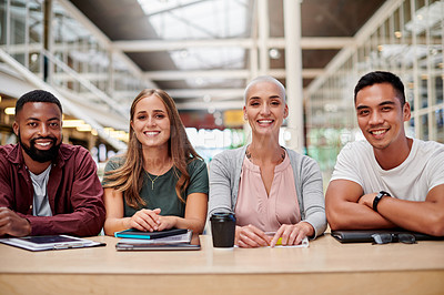 Buy stock photo Cropped portrait of a group of young businesspeople sitting in their office boardroom during a seminar