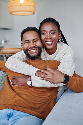 Buy stock photo Portrait of an affectionate young couple relaxing together at home