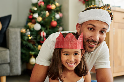 Buy stock photo Cropped portrait of a handsome young man and his adorable little daughter at home on Christmas eve