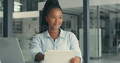 Buy stock photo Shot of a young woman her digital tablet in a modern office