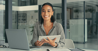 Buy stock photo Portrait of a young woman using her digital tablet and laptop to get her work done in a modern office