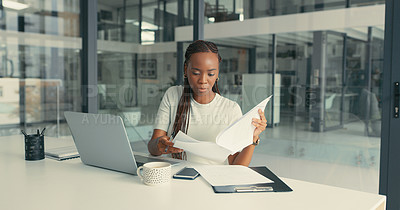 Buy stock photo Shot of a beautiful young woman doing some paperwork in a modern office