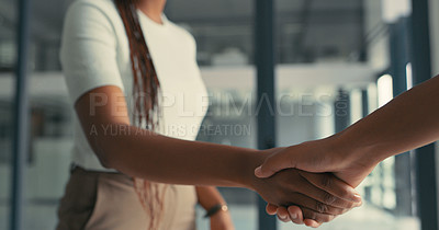 Buy stock photo Cropped shot of an unrecognizable woman shaking hands in agreement in a modern office
