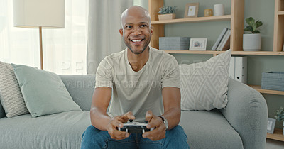 Buy stock photo Shot of a young man gaming at home
