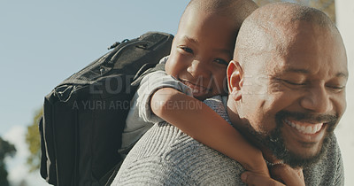 Buy stock photo Shot of a mature man and his grandson hugging outside